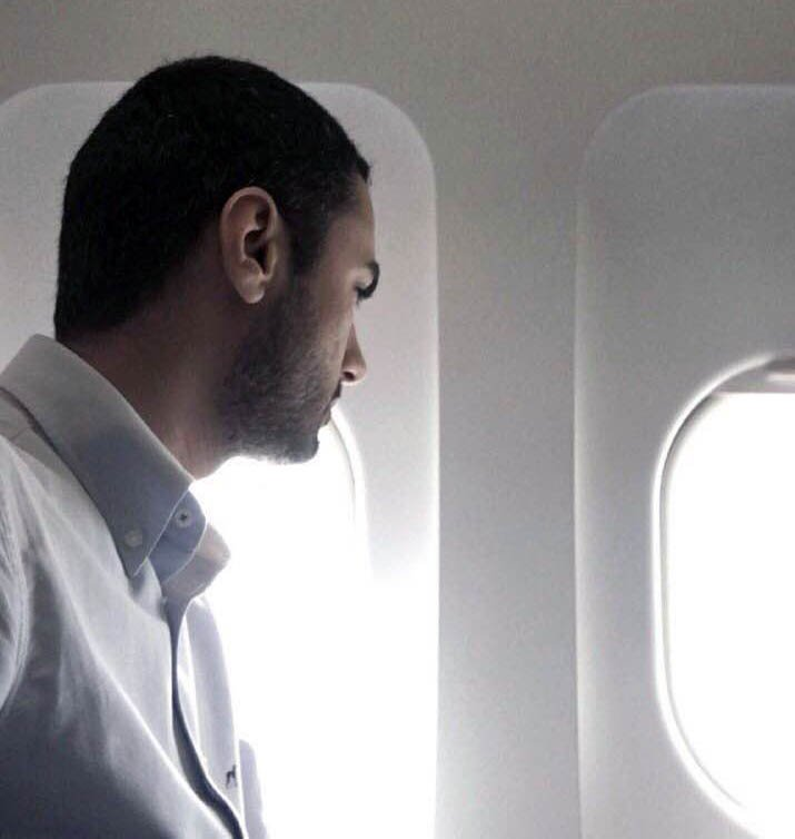 Farhad Pakan is looking outside of the airplane window
